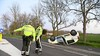 Auto over de kop bij botsing met busje in Alphen aan den Rijn