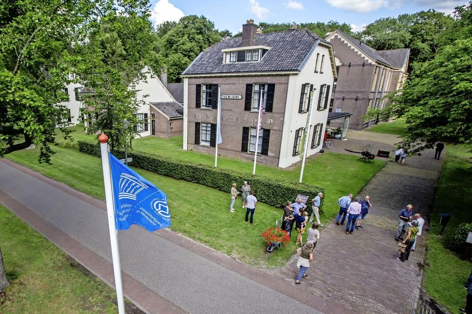 VEENHUIZEN - De Unesco vlag in top in Veenhuizen, een van de voormalige Kolonien van Weldadigheid, in 1818 gebouwd met als doel om arme paupers uit de grote steden een beter bestaan te geven op het platteland.